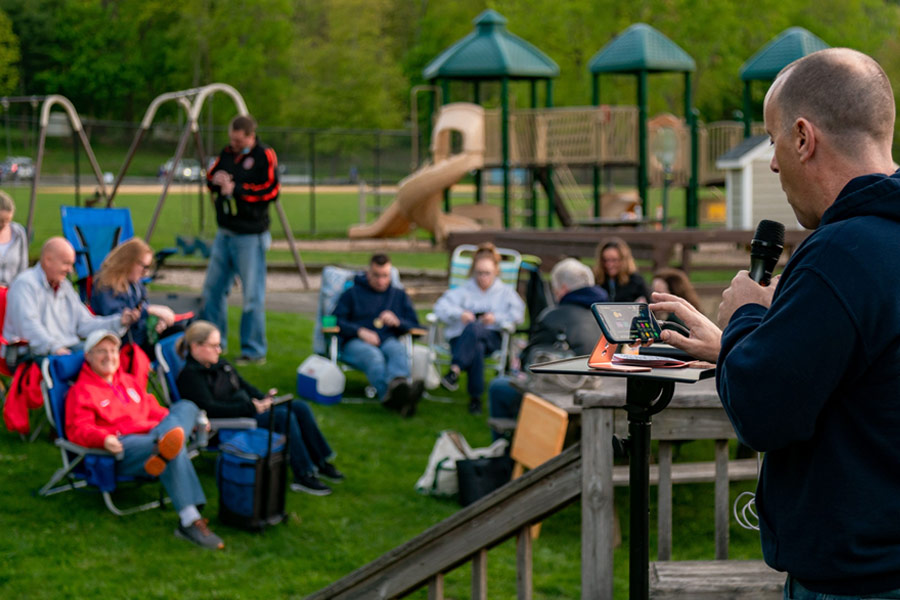 Garry hosting trivia outdoors in a park
